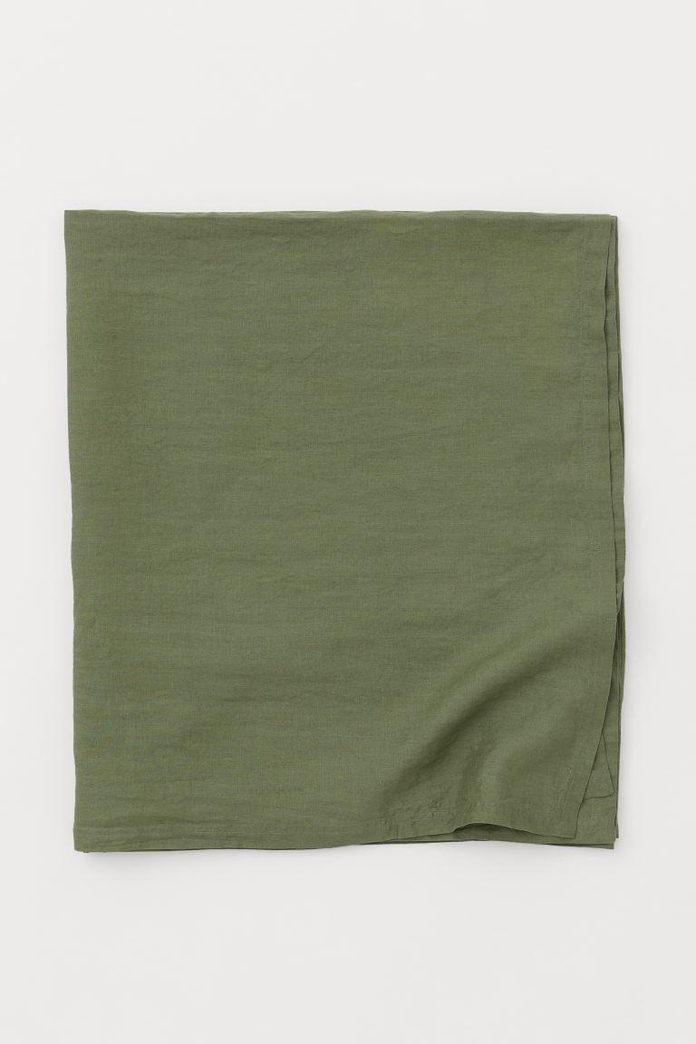 <p>Create fall vibes on your dining table with this <span>H&amp;M Washed Linen Tablecloth</span> ($50).</p>