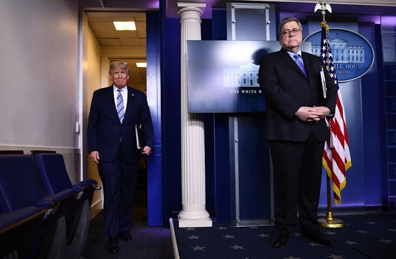 Donald Trump arrives for a White House briefing on the coronavirus pandemic as Attorney General William Barr looks on: AFP via Getty Images