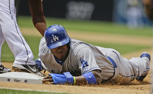 Los Angeles Dodgers' Yasiel Puig is picked off first base in the fourth inning against the San Diego Padres in a baseball game in San Diego, Sunday, June 23, 2013. (AP Photo/Lenny Ignelzi)