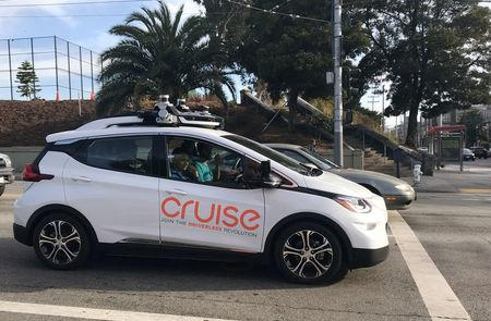 FILE PHOTO: A Cruise self-driving car, which is owned by General Motors Corp, is seen outside the company's headquarters in San Francisco