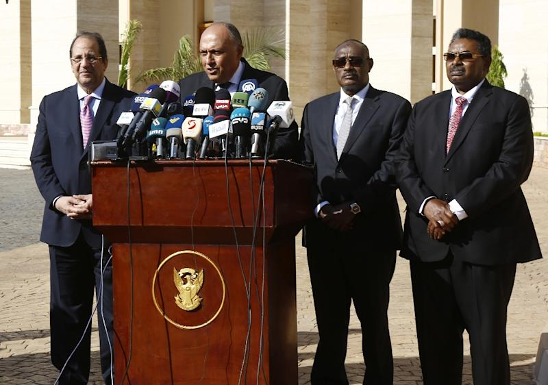 Egyptian intelligence chief Abbas Kamel, Foreign Minister Sameh Shoukry, Sudanese Foreign Minister Al-Dierdiry Ahmed and Sudanese National Intelligence and Security Service head Salah Ghosh in Khartoum on December 27, 2018 (AFP Photo/ASHRAF SHAZLY)