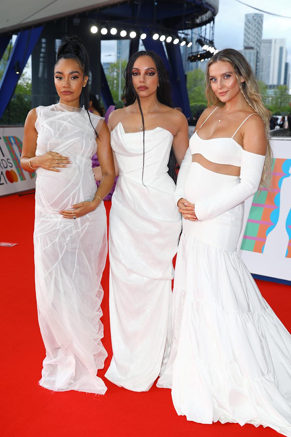 -Anne Pinnock, Jade Thirlwall and Perrie Edwards of Little Mix arrive at The BRIT Awards 2021 at The O2 Arena on May 11, 2021 in London, England. (Photo by JMEnternational/JMEnternational for BRIT Awards/Getty Images)