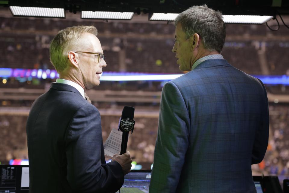 Troy Aikman, right, and Joe Buck in the booth before an NFL game.