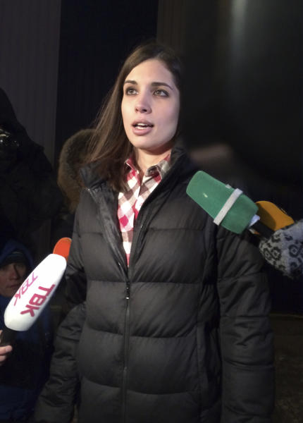 Nadezhda's Tolokonnikova speaks to the media after leaving a prison in Krasnoyarsk, Russia, Monday, Dec. 23, 2013. The third member of the Russian punk bank Pussy Riot has been released from custody following an amnesty law passed by parliament. Tolokonnikova left the prison colony in the eastern Siberian city Krasnoyarsk on Monday, hours after another band member, Maria Alekhina, was released in another region. (AP Photo/Alexander Roslyakov)