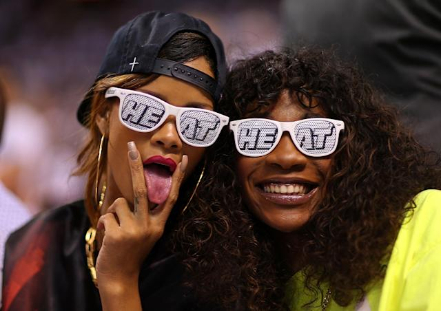 MIAMI, FL - APRIL 21: Rihanna (L) attends game 1 of the Eastern Conference Quarterfinals of the 2013 NBA Playoffs between the Miami Heat and the Milwaukee Bucks at American Airlines Arena on April 21, 2013 in Miami, Florida. NOTE TO USER: User expressly acknowledges and agrees that, by downloading and or using this photograph, User is consenting to the terms and conditions of the Getty Images License Agreement. (Photo by Mike Ehrmann/Getty Images)
