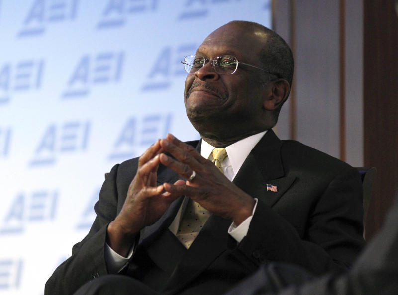 """FILE - In this Oct. 31, 2011, file photo Republican presidential candidate Herman Cain speaks at the American Enterprise Institute for Public Policy Research (AEI) in Washington. Cain does not shy away from using race as a talking point, much to the consternation of liberal and independent blacks. He said blacks have been """"brainwashed"""" into voting for Democrats in large numbers and shuns the term """"African-American,"""" preferring to call himself an """"American black conservative.""""  (AP Photo/Pablo Martinez Monsivais, File)"""