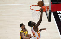 Atlanta Hawks center Clint Capela (15) shoots and scores during the second half of an NBA basketball game against the Indiana Pacers on Sunday, April 18, 2021, in Atlanta. (AP Photo/Brynn Anderson)