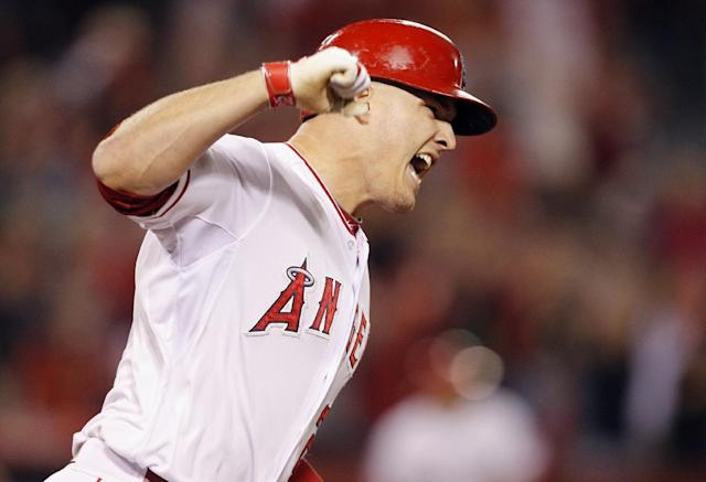 Los Angeles Angels' Mike Trout lets out a yell rounding first base after he hits a grand slam home run against the Chicago White Sox in the eighth inning of a baseball game on Saturday, June 7, 2014 in Anaheim, Calif. (AP Photo/Alex Gallardo)
