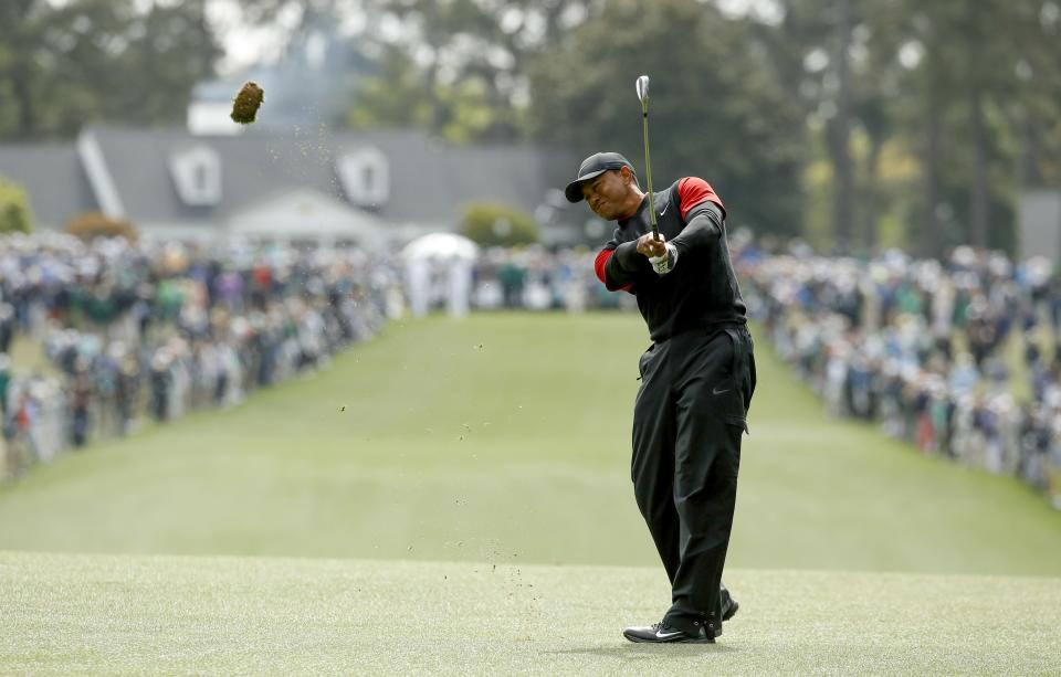 Tiger Woods hits on the first fairway during the fourth round at the Masters golf tournament Sunday, April 8, 2018, in Augusta, Ga. (AP)