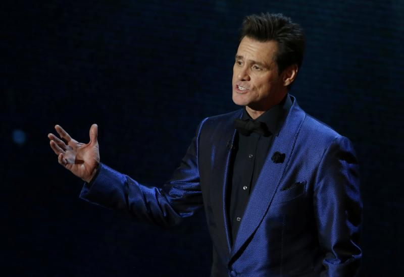 Actor Jim Carrey introduces animated feature clips at the 86th Academy Awards in Hollywood, California March 2, 2014. REUTERS/Lucy Nicholson (UNITED STATES - Tags: ENTERTAINMENT) (OSCARS-SHOW)