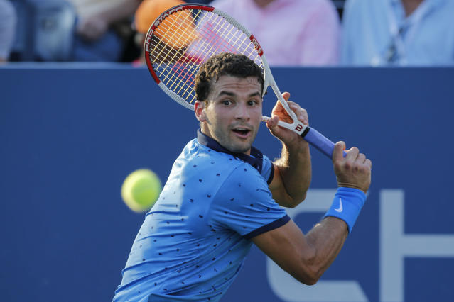 Grigor Dimitrov of Bulgaria returns a shot to Ryan Harrison of the US during their US Open men's singles match, at the USTA Billie Jean King National Tennis Center in New York, on August 27, 2014 (AFP Photo/Kena Betancur)