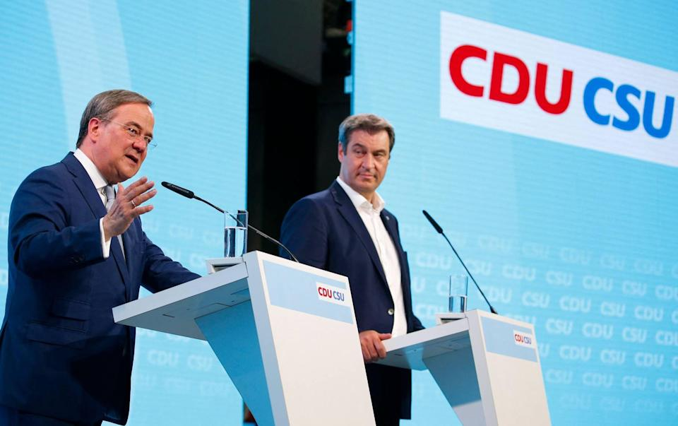 Christian Democratic Union (CDU) leader Armin Laschet and Christian Social Union (CSU) leader Markus Söder give a press conference after a congress of the conservative CDU/CSU sister parties in Berlin, Germany on Monday. Photo: AFP