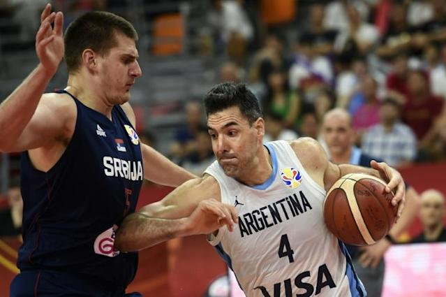 Luis Scola (R), 39 years old and the last remaining member of Argentina's 'Golden Generation' that won the Olympics in 2004, finished with a team-high 20 points in the 97-87 win over Serbia (AFP Photo/Ye Aung Thu )