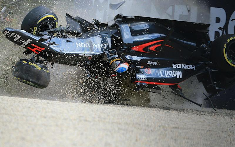 In this photo taken on March 20, 2016, McLaren Honda's Spanish driver Fernando Alonso crashes into the wall after colliding with Haas F1 Team's Brazilian driver Esteban Gutierrez during the Formula One Australian Grand Prix in Melbourne. / AFP PHOTO / Newspix / Alex Coppel / - Australia OUT / IMAGE RESTRICTED TO EDITORIAL USE - STRICTLY NO COMMERCIAL USE == NO ARCHIVE ALEX COPPEL/AFP/Getty Images  - Credit: ALEX COPPEL/AFP/Getty