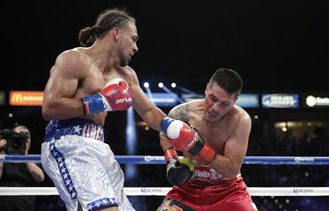 Keith Thurman, left, lands a punch to the face of Julio Diaz during the third round of a WBA interim welterweight title boxing match on Saturday, April 26, 2014, in Carson, Calif. Thurman won by TKO after the third round. (AP Photo/Jae C. Hong)