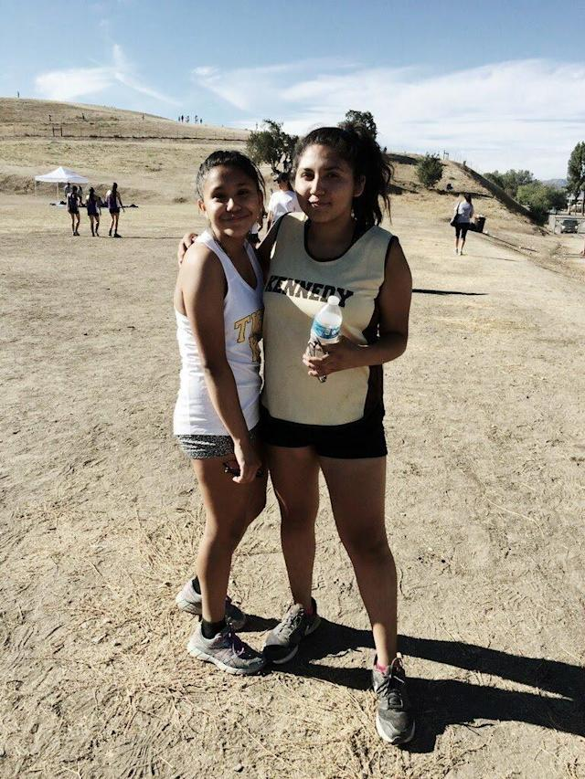 Citlaly Ortega, right, with her friend Reanna Casarez at a cross-country meetinOctober 2016. (Citlaly Ortega)