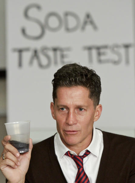 Bruce Bozzi, executive vice president of Palm Restaurant Group, participate in a soda taste test on Wednesday, June 27, 2012 in New York. The Coca-Cola Co., PepsiCo Inc. and Dr Pepper Snapple Group Inc. have worked to come up with sodas that have fewer calories but still taste good. (AP Photo/Bebeto Matthews)