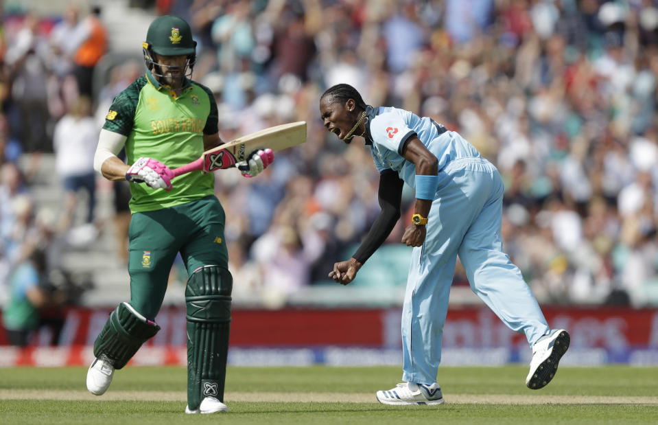 England's Jofra Archer celebrates taking the wicket of South Africa's captain Faf du Plessis, left, during the World Cup cricket match between England and South Africa at The Oval in London, Thursday, May 30, 2019. (AP Photo/Kirsty Wigglesworth)