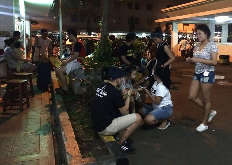 Residents gather outside their apartment blocks in Jakarta following a strong earthquake