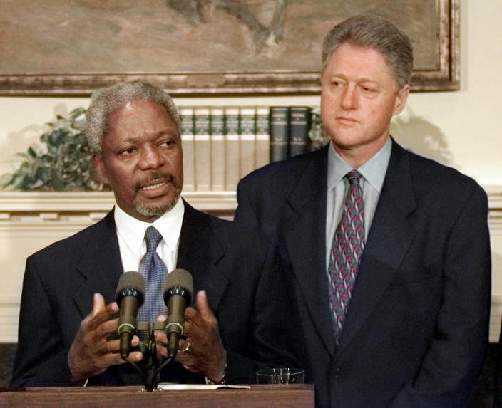 FILE - In this Thursday Jan. 23, 1997 file photo President Clinton looks on as United Nations Secretary General Kofi Annan answers a reporters question during their joint news conference at the White House after their Oval Office meeting. Annan, one of the world's most celebrated diplomats and a charismatic symbol of the United Nations who rose through its ranks to become the first black African secretary-general, has died. He was 80. (AP Photo/Greg Gibson, File)