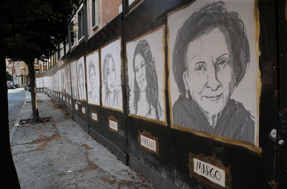 Sketches of victims of the port explosion hang on a wall in downtown Beirut (EPA)