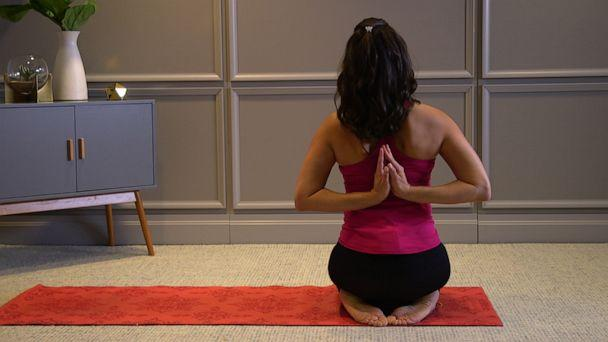 PHOTO: Health and wellness expert Stephanie Mansour shows us how to perform reverse prayer with a neck stretch. (ABC News)