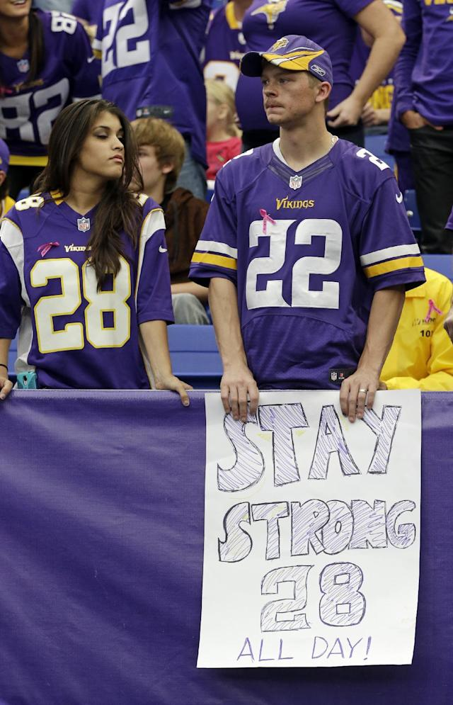 Minnesota Vikings fans hold a sign supporting Vikings running back Adrian Peterson during the second half of an NFL football game in Minneapolis, Sunday, Oct. 13, 2013. One of the star running back's sons, a 2-year-old in South Dakota, died Friday after an alleged attack in a child abuse case. The Carolina Panthers defeated the Vikings 35-10. (AP Photo/Jim Mone)