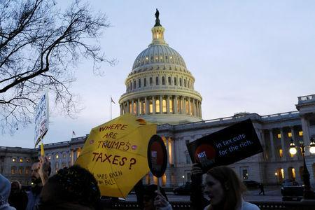 Demonstrators gather outside the U.S. Capitol to protest the Republican tax plan as it works through the Senate in Washington November 30, 2017. REUTERS/James Lawler Duggan