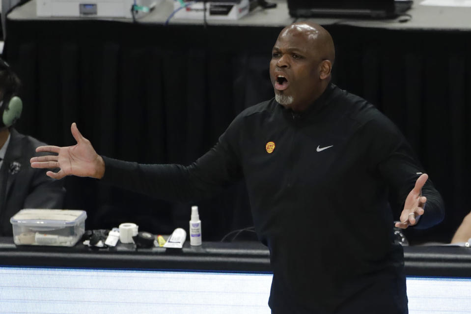 Atlanta Hawks' head coach Nate McMillan reacts to a call during the first half of Game 5 of the NBA Eastern Conference Finals against the Milwaukee Bucks Thursday, July 1, 2021, in Milwaukee. (AP Photo/Aaron Gash)