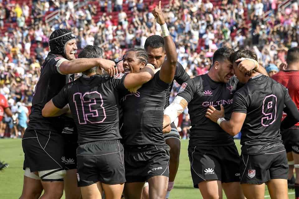 Giltinis teammates celebrate with Ryan James after he scored a try against the Utah Warriors in the second half.