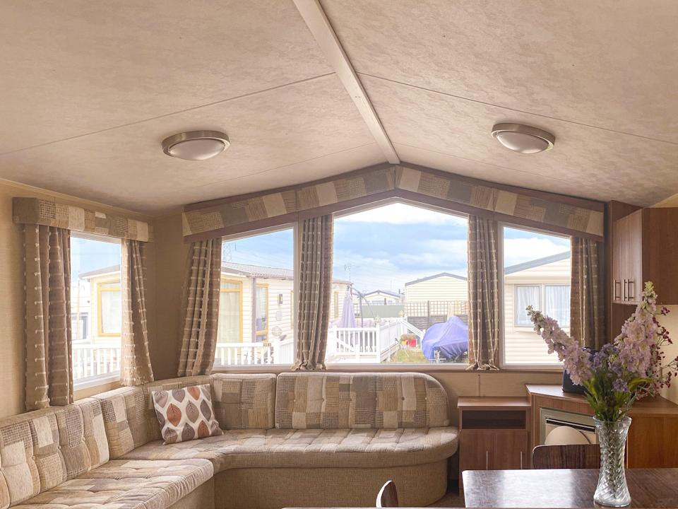 """BEFORE: """"The caravan was perfectly acceptable when we bought it,"""" says Anna of the preloved 2010 Willerby BK Bluebird. """"But it wasn't the kind of place you'd see on the pages of say, Condé Nast Traveler. Or that people like us would want to stay in."""""""
