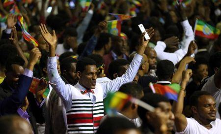 Residents cheer as they attend a concert at the Millennium Hall in Addis Ababa, Ethiopia July 15, 2018. REUTERS/Tiksa Negeri