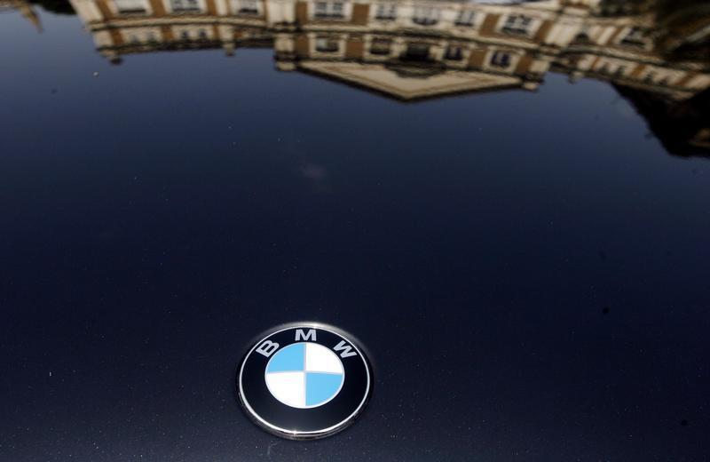 Building is reflected on the bonnet of a BMW car at a Super Car Show in Mumbai