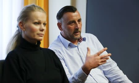 """File phot of Lutz Bachmann (R) and Kathrin Oertel, leaders of anti-immigration group PEGIDA, a German abbreviation for """"Patriotic Europeans against the Islamization of the West"""", during a Reuters interview in Dresden January 12, 2015. REUTERS/Fabrizio Bensch/Files"""