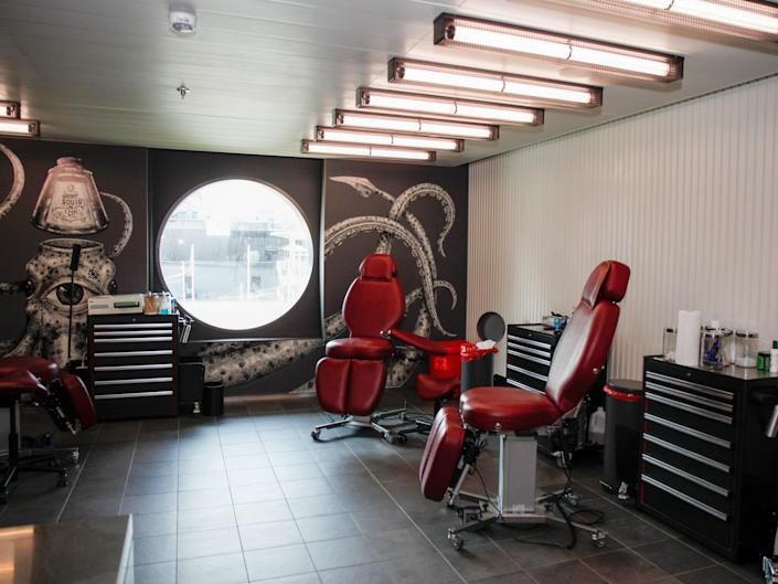 a tattoo parlor with two seats