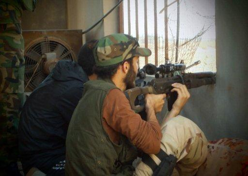 """Picture from the Syrian opposition's Shaam News Network on July 17, shows Free Syrian Army militants in Qusayr. Rebels declared the battle to """"liberate"""" Damascus has begun as heavy fighting raged across the city. AFP is using pictures from alternative sources and is not responsible for any alterations which cannot be independently verified"""