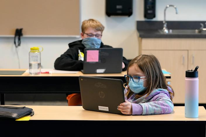 Students wear masks as they work in a fourth-grade classroom in Washington state in February 2021.