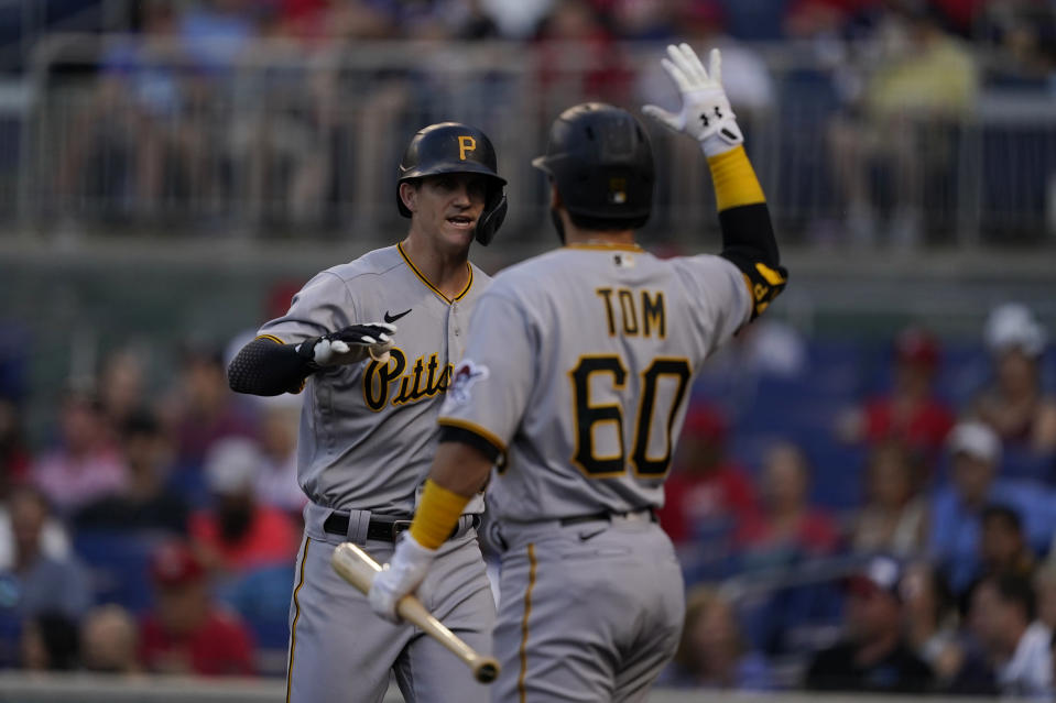Pittsburgh Pirates' Kevin Newman, left, celebrates after hitting a home run with teammate Ka'ai Tom during the first inning of a baseball game against the Washington Nationals, Monday, June 14, 2021, in Washington. (AP Photo/Carolyn Kaster)