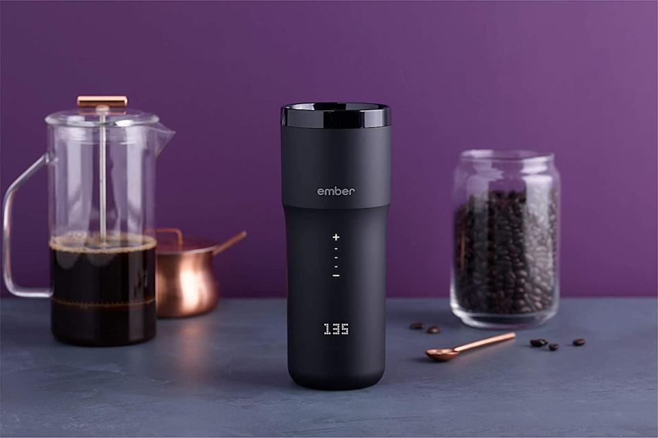 <p>The <span>NEW Ember Temperature Control Travel Mug 2, 12 oz, Black, 3-hr Battery Life - App Controlled Heated Coffee Travel Mug - Improved Design</span> ($180) is an app-controled heated travel mug that will keep your drink hot for much longer. It's got a three hour battery life and such a sleek design.</p>