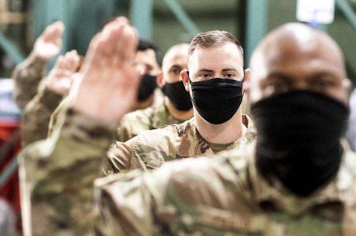 Master Sgt. Jeffery Health takes an oath during a ceremony for U.S. Air Force airmen transitioning to U.S. Space Force guardian designations on Friday, Feb. 12, 2021, at Travis Air Force Base, Calif. (AP Photo/Noah Berger)