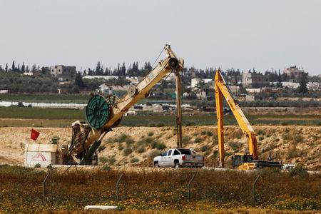 FILE PHOTO: Construction work can be seen on the Israeli side of the border between Israel and the Gaza Strip