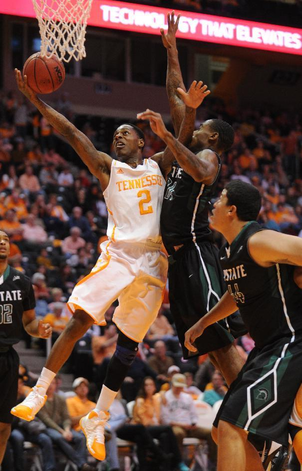 Tennessee's Antonio Barton gets a layup under pressure from South Carolina-Upstate defenders during the first half of an NCAA college basketball game at Thompson-Boling Arena in Knoxville, Tenn., Saturday, Nov. 16, 2013. (AP Photo/The Knoxville News Sentinel, Amy Smotherman Burgess)
