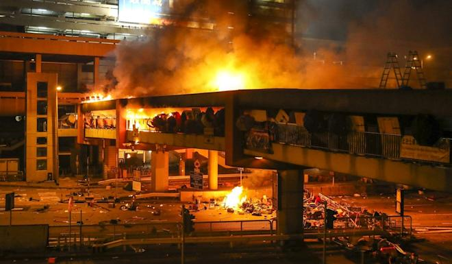 A massive fire breaks out on the footbridge connecting Hung Hom MTR station and PolyU as radicals clash with police. Photo: Winson Wong