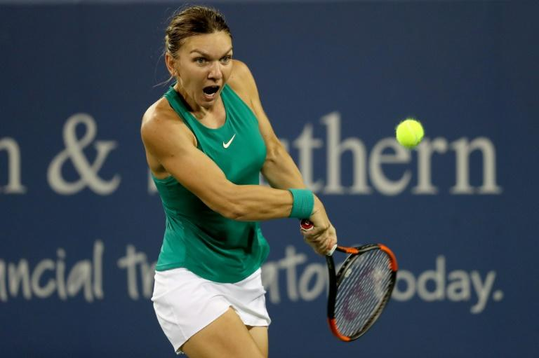 Simona Halep of Romania returns a shot to Ajla Tomjanovic of Australia during the Western & Southern Open, at Lindner Family Tennis Center in Mason, Ohio, on August 15, 2018