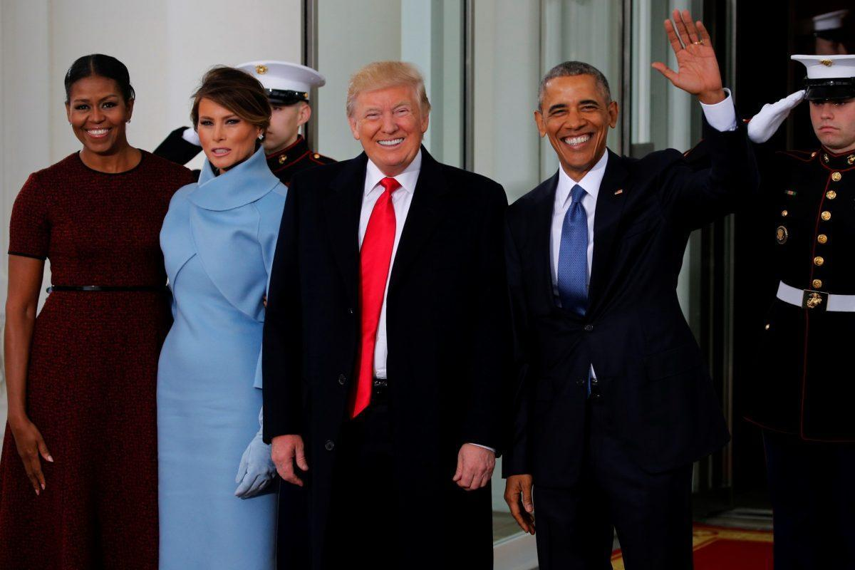 U.S. President Barack Obama (R) and first lady Michelle Obama (L) greet U.S. President-elect Donald Trump and his wife Melania for tea before the inauguration at the White House in Washington, U.S. January 20, 2017. REUTERS/Jonathan Ernst