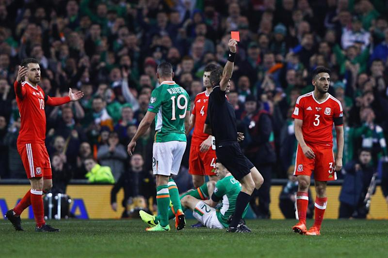 Neil Taylor is sent off for his horror challenge on Coleman: Getty Images