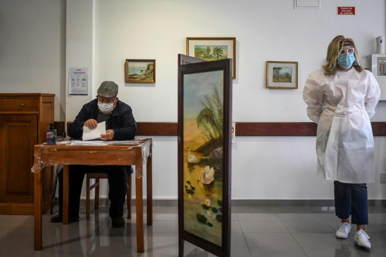 Despite the health emergency in place since November, Sunday's presidential election could not be postponed under national law