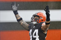 Cleveland Browns linebacker Sione Takitaki celebrates after running for a 50-yard interception return touchdown during the first half of an NFL football game against the Philadelphia Eagles, Sunday, Nov. 22, 2020, in Cleveland. (AP Photo/Ron Schwane)