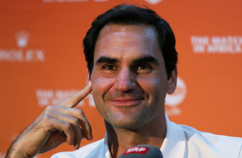 FILE PHOTO: Roger Federer speaks during a media briefing  at Cape Town International Airport ahead of his exhibition tennis match against Rafael Nada