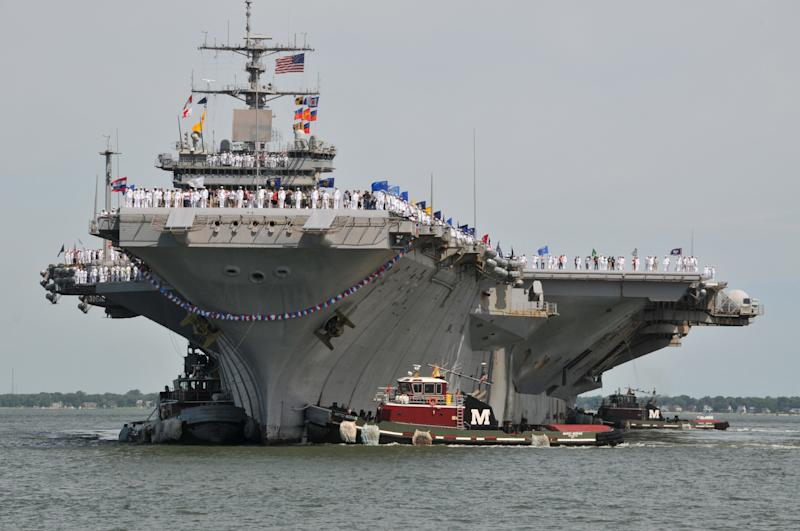 In this photo provided by the Navy Visual News Service, the aircraft carrier USS Enterprise (CVN 65) arrives Friday, July 15, 2011 at Naval Station Norfolk, Va., after a six-month deployment to the U.S. 5th and 6th Fleet areas of responsibility.  (AP Photo/Navy Visual News Service, MC2 Rafael Martie)
